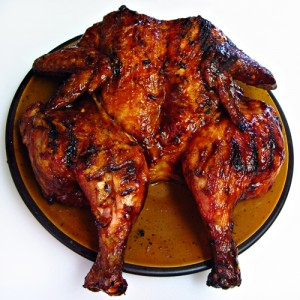 Grilled and Butterflied Whole Chicken with Barbecue Sauce (also known as a Grilled Spatchcocked Chicken).
