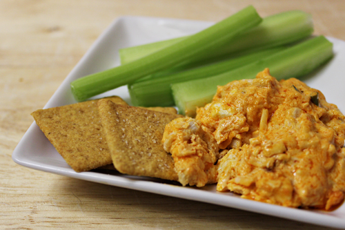 Buffalo Chicken Dip with crackers and celery sticks