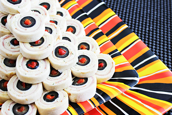 heres an easy halloween party foods idea eyeball pinwheels they give the creepy look