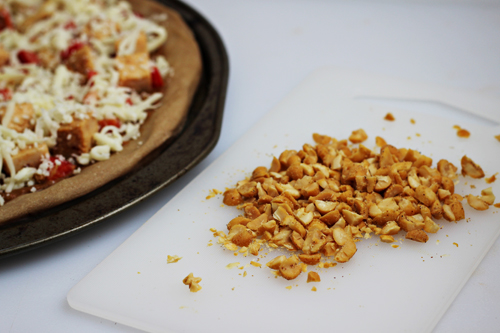 Top your Asian Chicken Pizza with mozzarella cheese & peanuts