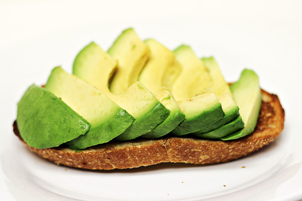 Sliced Ripe Avocados on Sourdough Toast