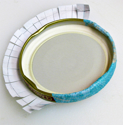 How to Make Pretty Lids for Old Jars: Glue Scrapbook Paper to Lid