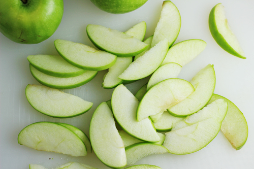 Sliced Granny Smith Apples for Autumn Sausage Couscous