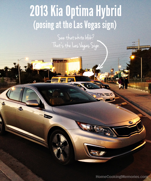 2013 Kia Optima Hybrid at the Las Vegas sign