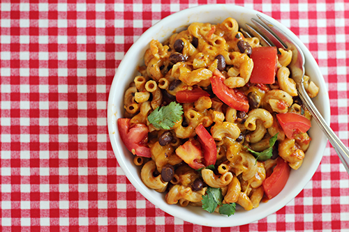 One-Pan Cheesy Salsa Pasta - a Mexican-inspired dinner idea that you can make easily in 30 minutes or less -- and you'll have only one pan to clean up!