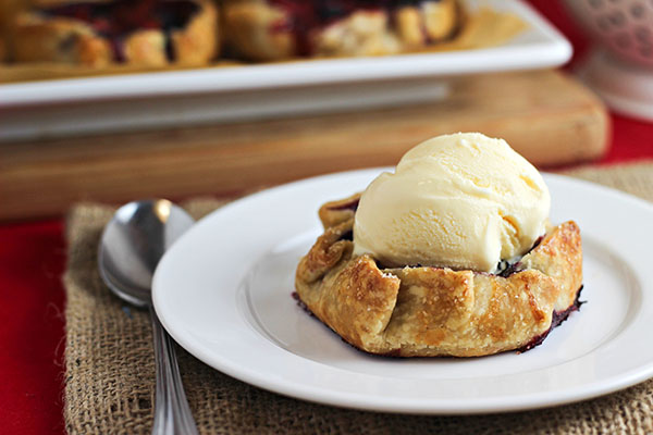 Mini Summer Berry Galettes with a scoop of vanilla ice cream