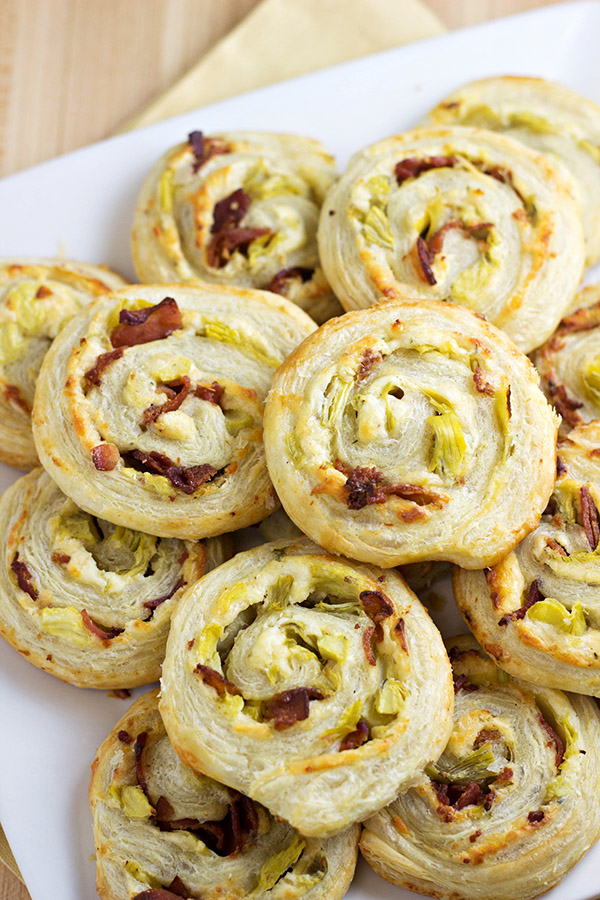 These Artichoke Bacon Pinwheels are an easy game day recipe that won't have you going into overtime in the kitchen!