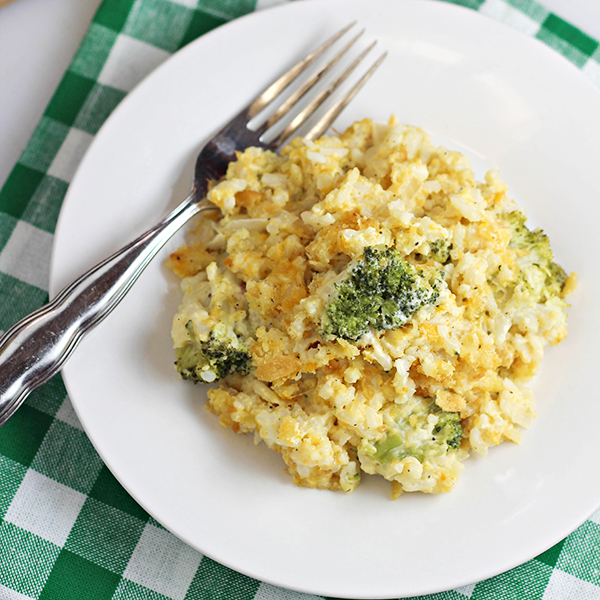 Easy Broccoli Rice Casserole recipe -- the ultimate comfort food! It's filling, great for potlucks, and easy to make for dinner or holiday parties.