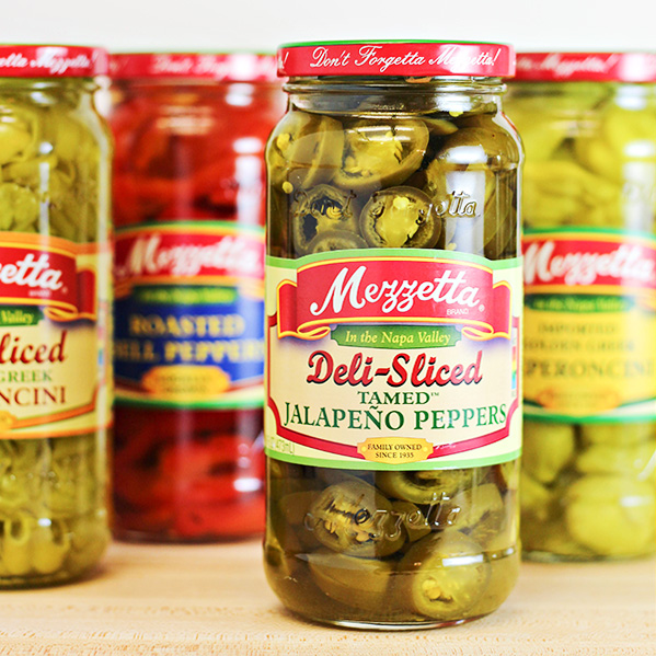 Assortment of Mezzetta brand products, including Mezzetta Deli-Sliced Tamed Jalapeno Peppers