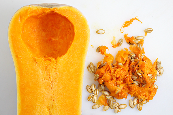 Removing seeds from a butternut squash