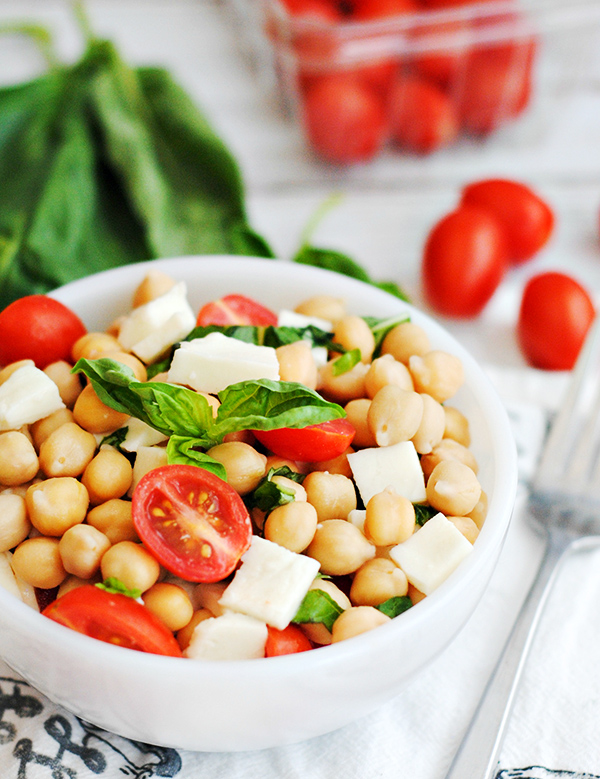 bowl of easy chickpea caprese salad recipe with tomatoes