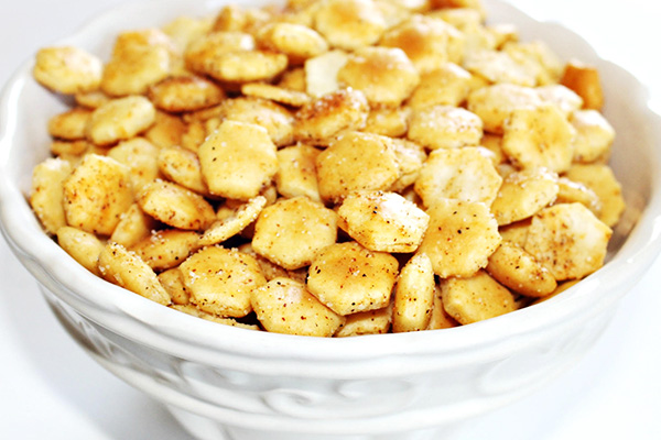 Oyster crackers seasoned and baked with Tony Chachere's Original Creole Seasoning, served in a while bowl