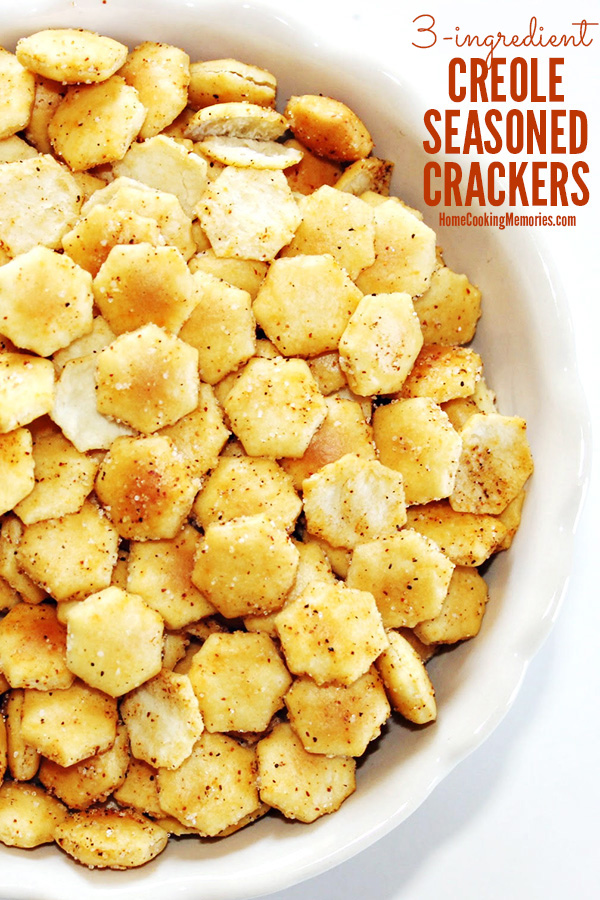 Close up of oyster crackers seasoned with Tony Chachere's Original Creole Seasoning, served in a while bowl