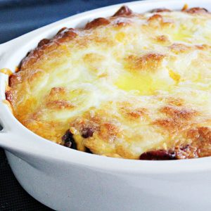 Easy Bacon Cheeseburger Casserole, baked in a white, oval casserole dish