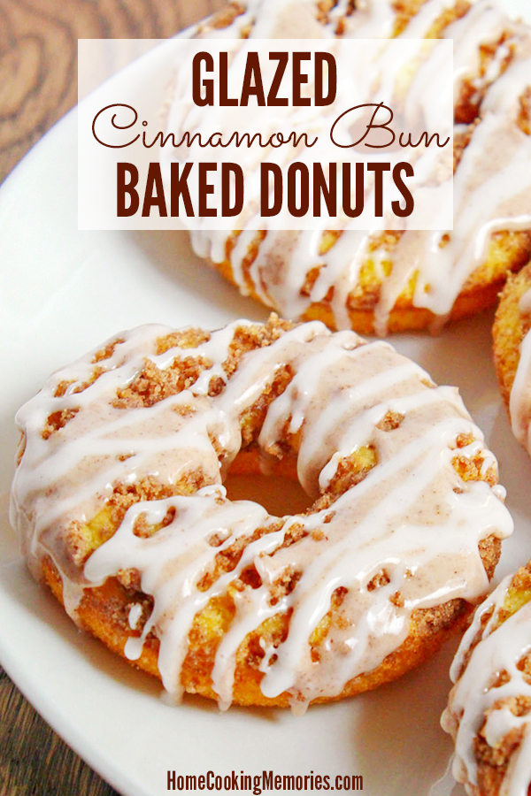The best of both worlds: cinnamon buns + donuts! This Glazed Cinnamon Bun Baked Donuts recipe is baked in the oven, includes two delicious icings and a cinnamon topping that will make you swoon! These are so good anytime, but especially wonderful with a cup of coffee or for serving to during a special breakfast or brunch.