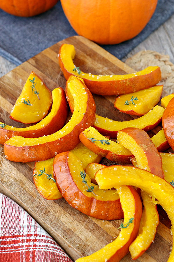 Sliced of oven-roasted pumpkin, with a sprinkle of fresh thyme