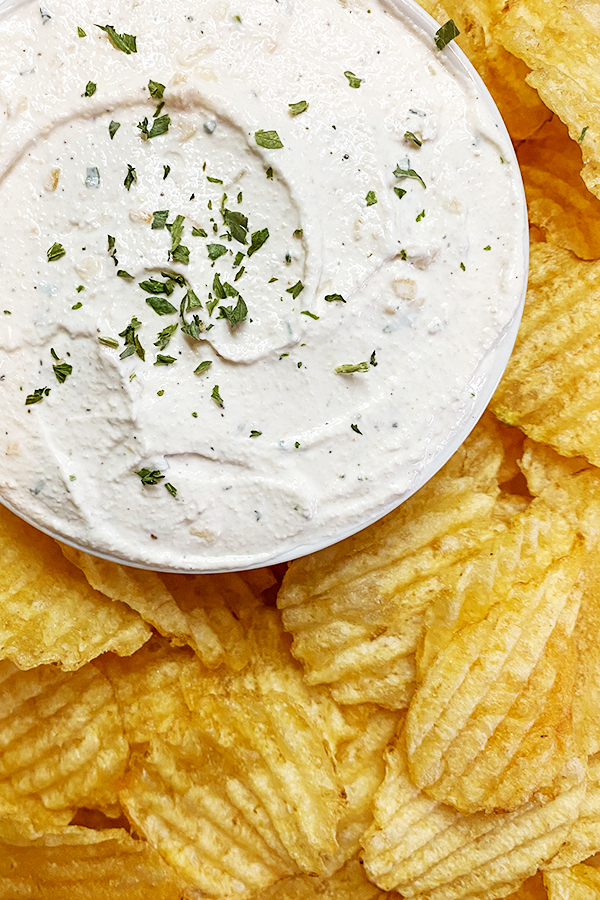 Platter of ripple potato chips with a bowl of homemade onion dip