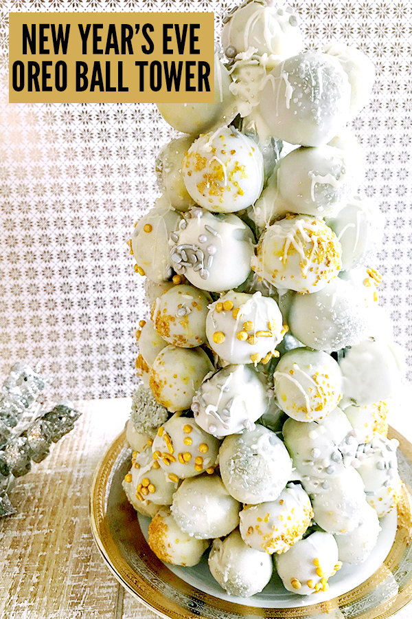 OREO Balls, coated in white chocolate and decorated with gold and silver sprinkles, stacked into a cone shaped tower
