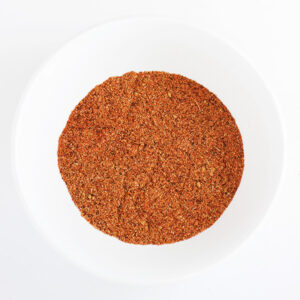 White bowl with a mixture of seasoning to create taco seasoning